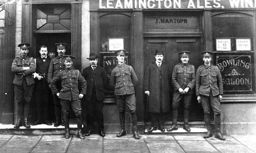 Group of soldiers and men standing outside The Railway Inn, Clemens Street.  1910s |  IMAGE LOCATION: (Warwickshire County Record Office)