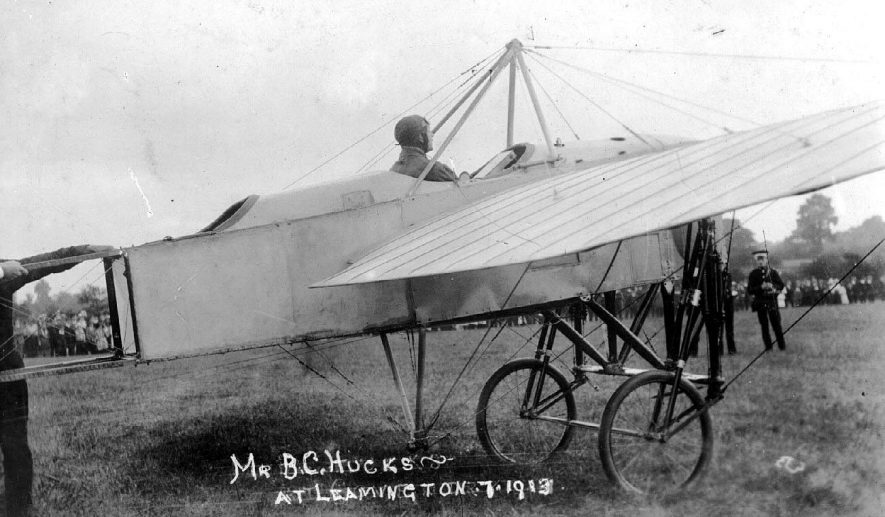 Mr  B.C. Hucks in his 70 horsepower, tandem Bleriot military type monoplane. Mr. Hucks gave a three day programme of flying displays at Shrubland Hall. There is however a possibility that this photograph was actually taken in Coventry.  July 1913 |  IMAGE LOCATION: (Warwickshire County Record Office) PEOPLE IN PHOTO: Hucks, B C