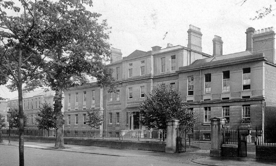 View of Warneford Hospital front, part of the street, railings and trees, Leamington Spa.  1900s |  IMAGE LOCATION: (Warwickshire County Record Office)