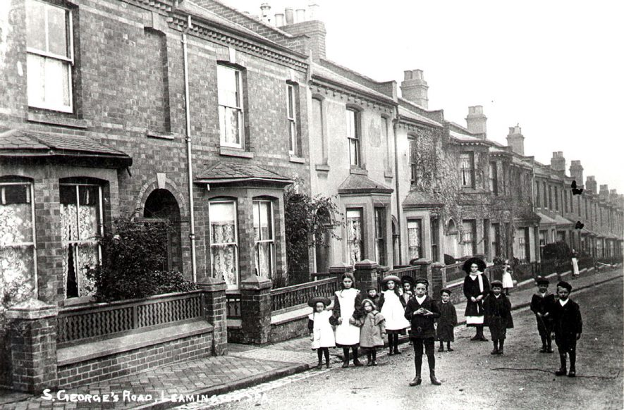 Terraced houses and a group of children standing in street, St George's Road, Leamington Spa.  1900s |  IMAGE LOCATION: (Warwickshire County Record Office)