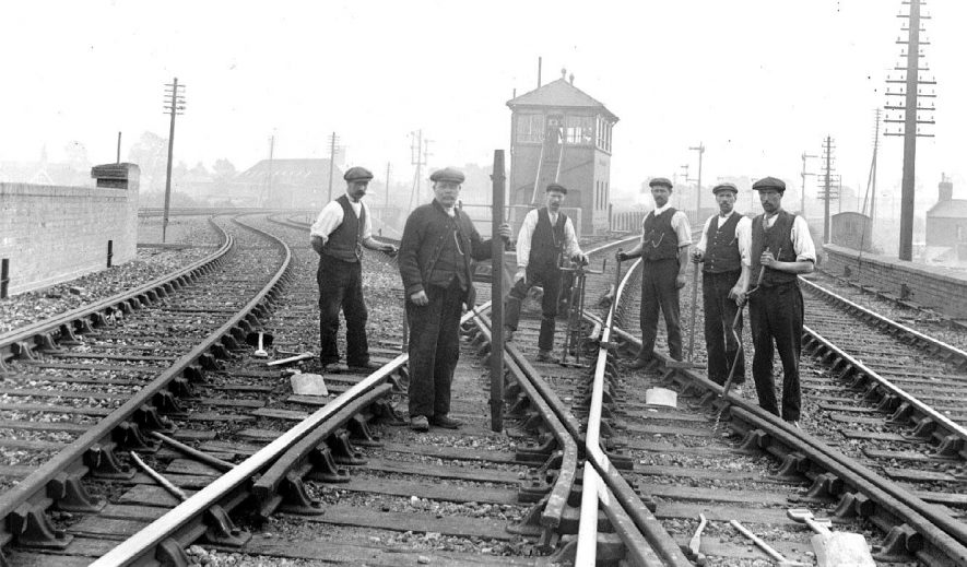 Railway workers on the line to the left to Rugby L.N.W.R. signal box in distance, Leamington Spa.  1900s |  IMAGE LOCATION: (Warwickshire County Record Office)