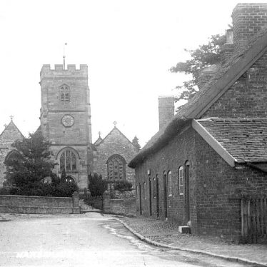 Harborough Magna.  Church and row of terraced houses