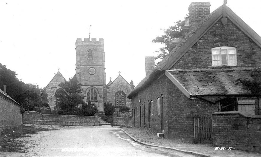 All Saints Church and row of small terraced cottages in Harborough Magna.  1920s |  IMAGE LOCATION: (Warwickshire County Record Office)