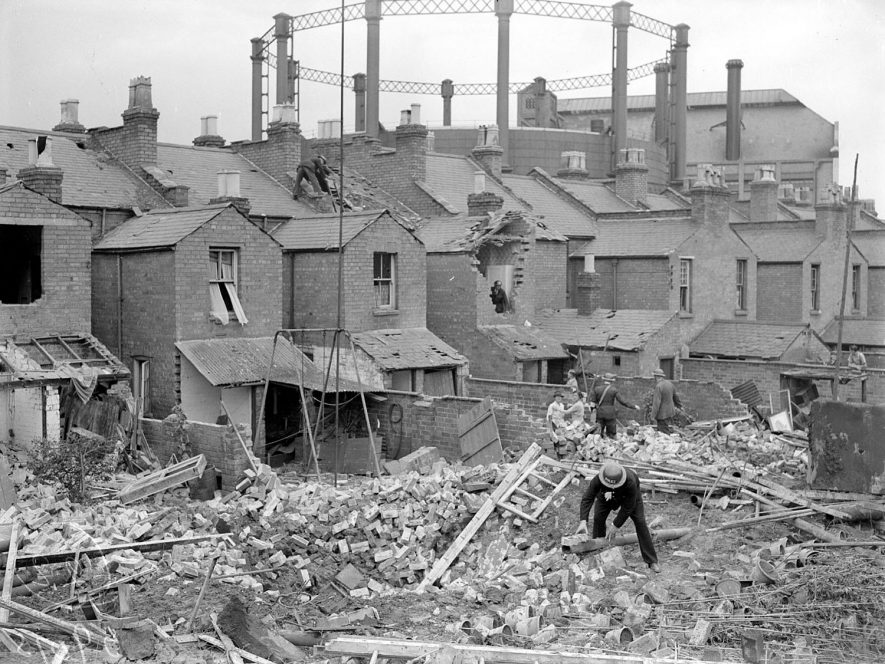 Bomb damaged terraced houses in Ranelagh Terrace, Leamington Spa.  Gas works in background.  1940