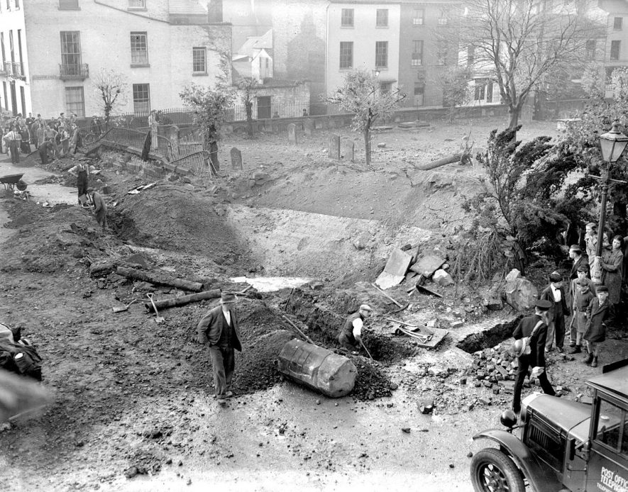 Bomb crater behind Parish Church, Leamington Spa.  1940    IMAGE LOCATION: (Warwickshire County Record Office)
