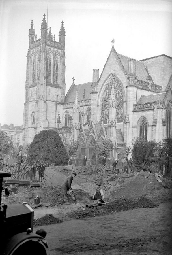 Bomb crater by Parish Church, Leamington Spa.  1940 |  IMAGE LOCATION: (Warwickshire County Record Office)