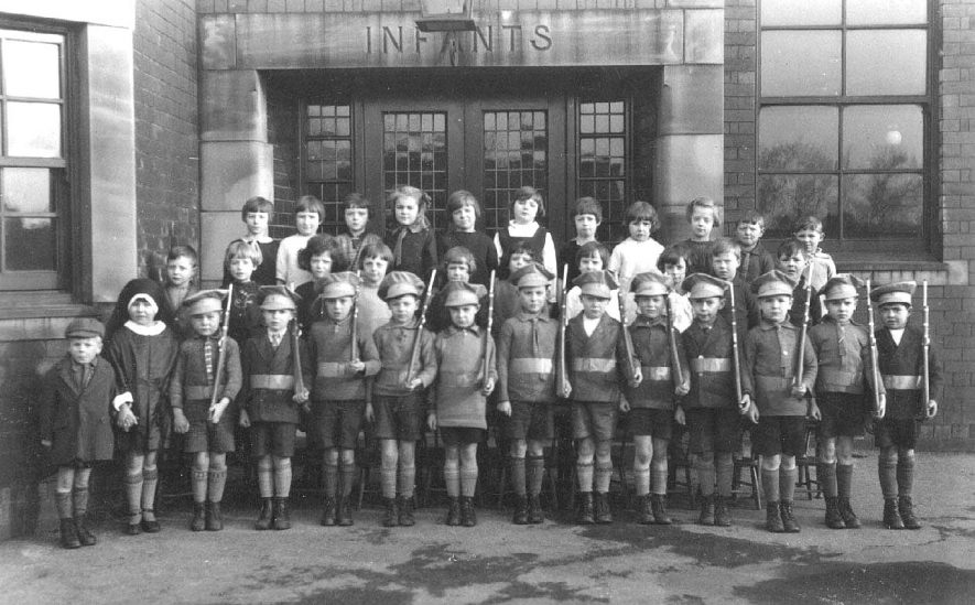 Group of children, some dressed as soldiers, outside a school in Leamington Spa.  1930s |  IMAGE LOCATION: (Warwickshire County Record Office)
