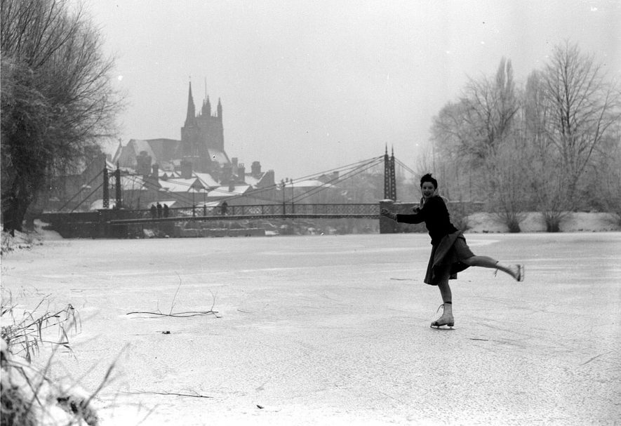Skater on River Leam, suspension bridge in distance.  29 January 1945 |  IMAGE LOCATION: (Warwickshire County Record Office)