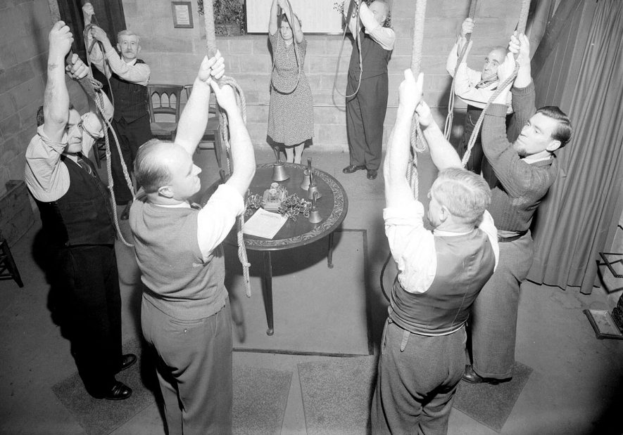 Bellringers in action at Leamington Parish Church.  10 December 1953 |  IMAGE LOCATION: (Warwickshire County Record Office)
