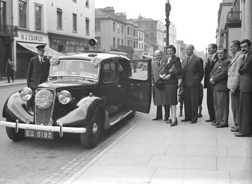 Mrs Eden with Sir Leslie Boyes and Mr Gibbs outside the Leamington Spa Conservative headquarters in Warwick Street.  29 June 1945 |  IMAGE LOCATION: (Warwickshire County Record Office) PEOPLE IN PHOTO: Gibbs, Mr, Gibbs as a surname, Eden, Mrs, Eden as a surname, Boyes, Sir Leslie, Boyes as a surname