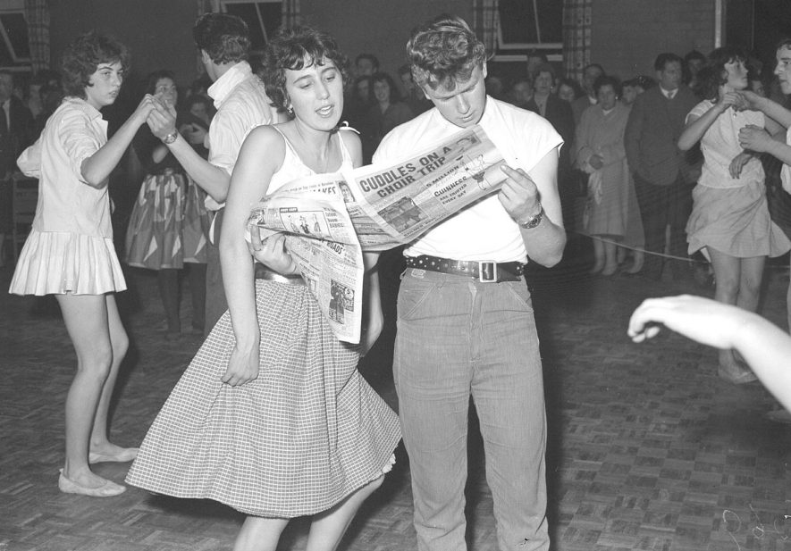 24 hour Jive marathon at Riverside Youth Club, Leamington Spa.  Rosie Holt and Neil Taylor taking a break.  1960 |  IMAGE LOCATION: (Warwickshire County Record Office) PEOPLE IN PHOTO: Taylor, Neil, Taylor as a surname, Holt, Rosie, Hutchings as a surname