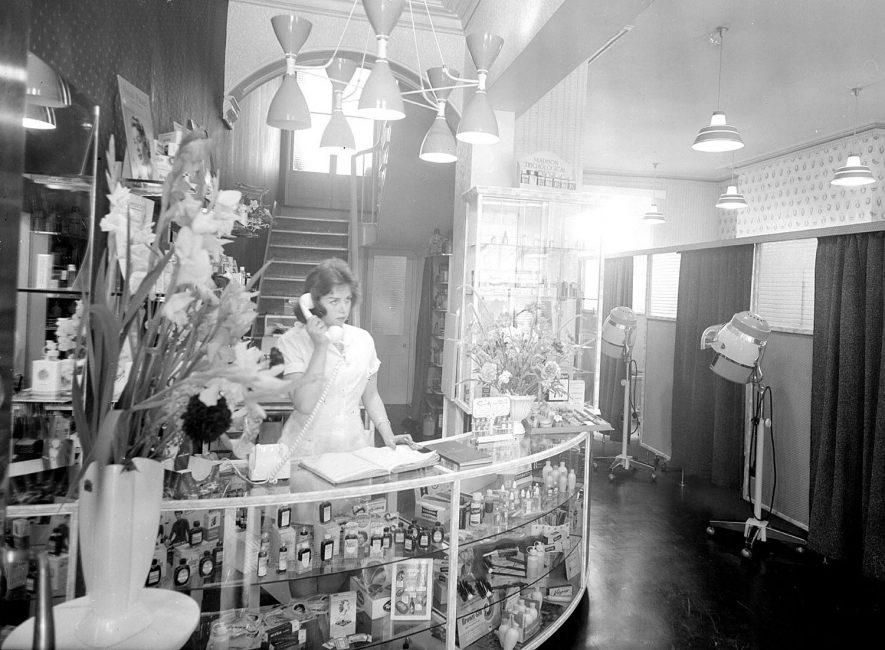 Interior view of the foyer at Allen Steel, Hairdresser, in The Parade, Leamington Spa. Receptionist at desk.  1960 |  IMAGE LOCATION: (Warwickshire County Record Office)