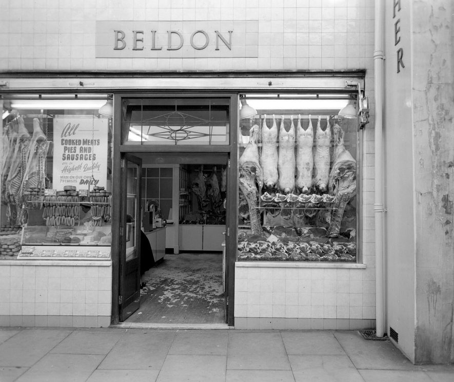 Front view of Beldon's butchers shop, showing the name