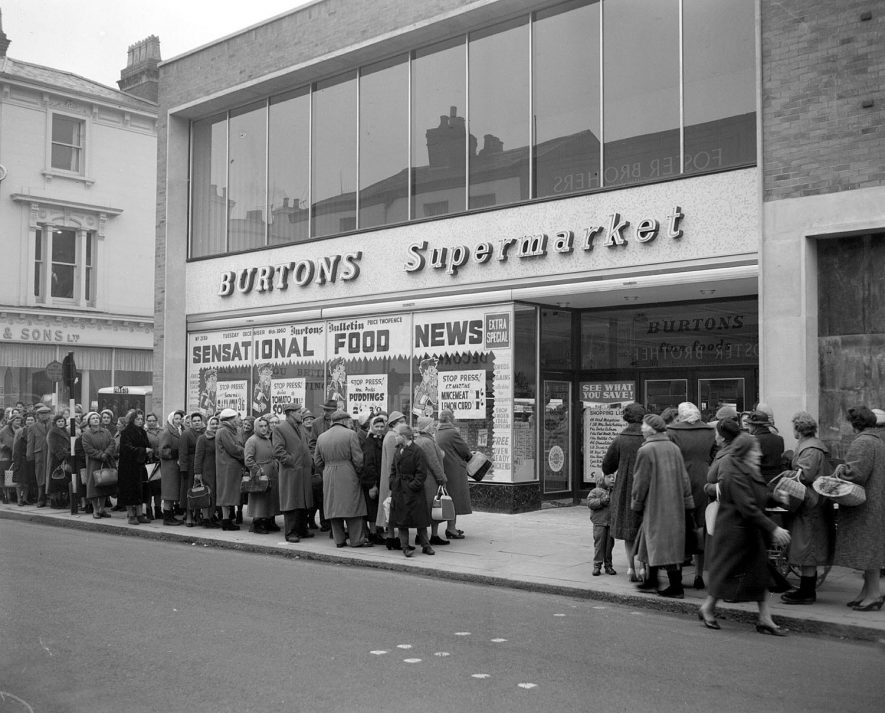Front exterior of Burtons Supermarket with crown queuing outside, Leamington Spa.  1960 |  IMAGE LOCATION: (Warwickshire County Record Office)