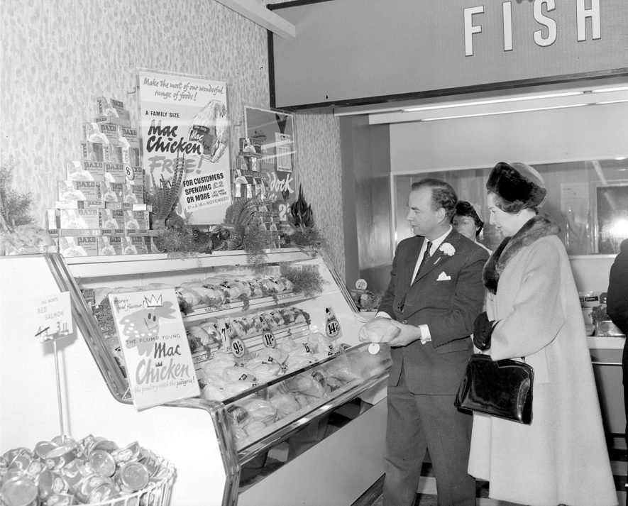 Opening of Macfisheries shop, Leamington Spa, manager and guest at a food display cabinet.  1961 |  IMAGE LOCATION: (Warwickshire County Record Office)