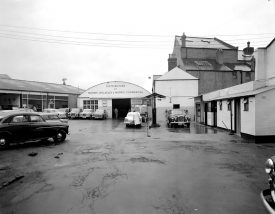 Motor cars and petrol pump with attendant on the forecourt of Regent Garage, Leamington Spa.  1962 |  IMAGE LOCATION: (Warwickshire County Record Office)