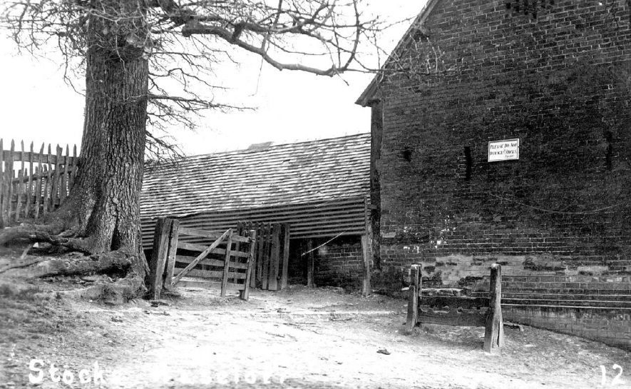 The stocks at Haselor.  1910s |  IMAGE LOCATION: (Warwickshire County Record Office)