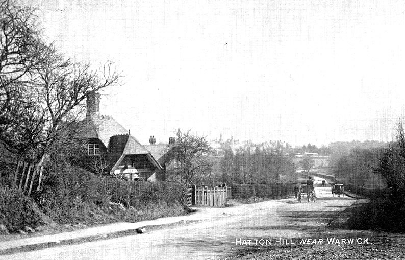 Hatton Hill, near Warwick. View of road going downhill. Horsedrawn vehicles, house on one side of road.  1900s |  IMAGE LOCATION: (Warwickshire County Record Office)