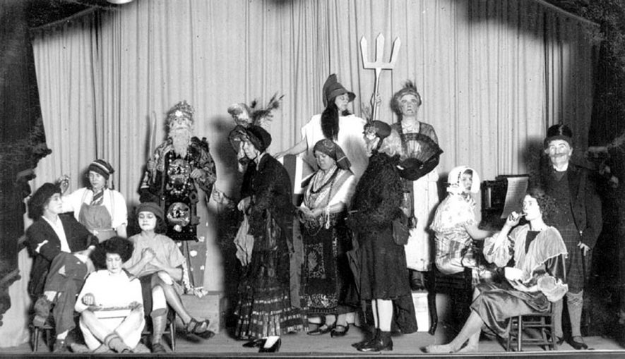 Costumed ladies on stage at village hall, Hatton.  1928 |  IMAGE LOCATION: (Warwickshire County Record Office)