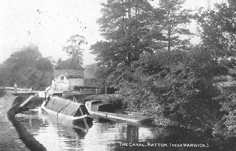 The canal, showing lock, cottage and working barges, Hatton.  1900s |  IMAGE LOCATION: (Warwickshire County Record Office)