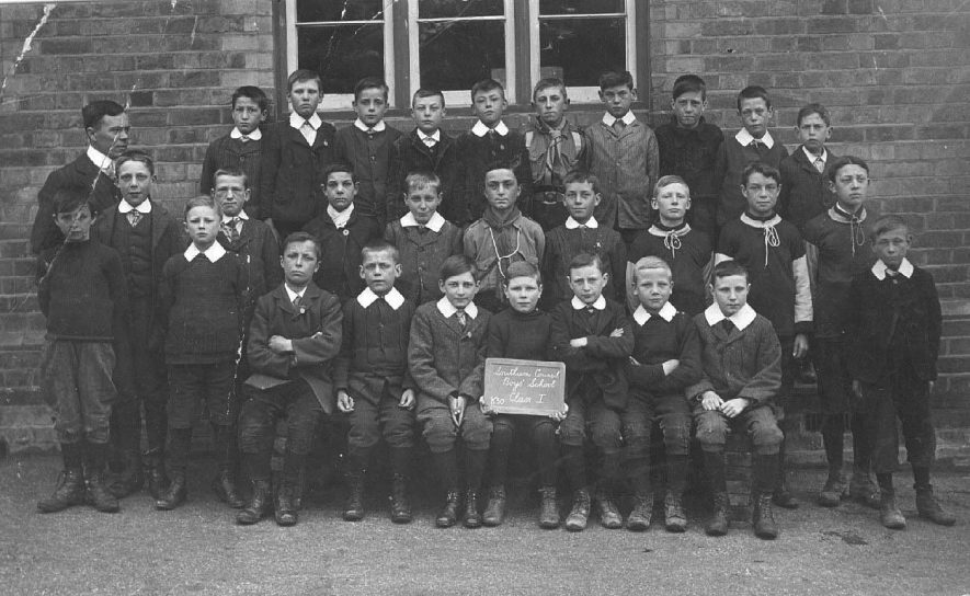 Southam Council Boys' School, Class I, K50; group photograph showing the boys with a master.  1910s |  IMAGE LOCATION: (Warwickshire County Record Office)