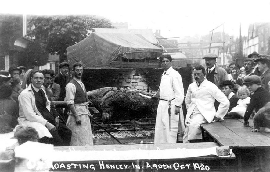 Ox roasting in Henley in Arden.  October 1920 |  IMAGE LOCATION: (Warwickshire County Record Office)