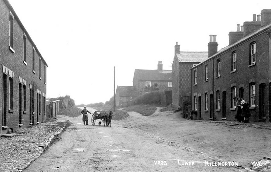 Man with pony and trap standing in road between terraced houses in Lower Street, Hillmorton. Cobbled pavements. 1900s |  IMAGE LOCATION: (Warwickshire County Record Office)
