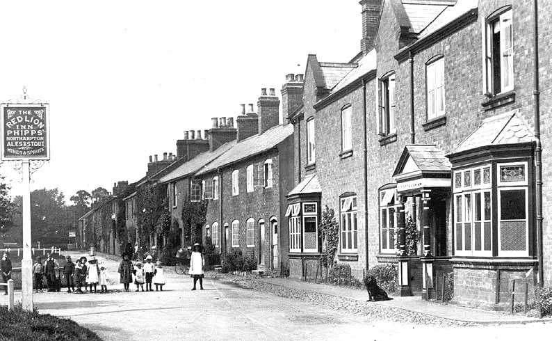 The Red Lion Inn, Hillmorton, with Phipps mentioned on the sign. Group of children standing in the road outside.  1900s |  IMAGE LOCATION: (Warwickshire County Record Office)