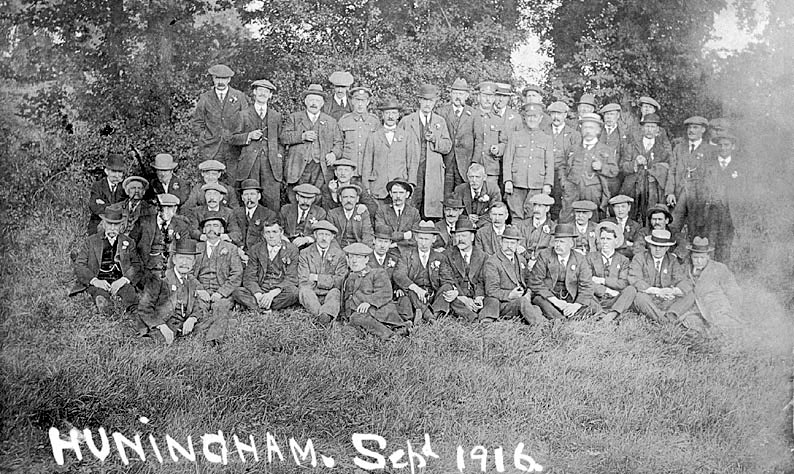 Group of middle-aged men by trees with three younger men in army uniform with them, Hunningham.  1916 |  IMAGE LOCATION: (Warwickshire County Record Office)