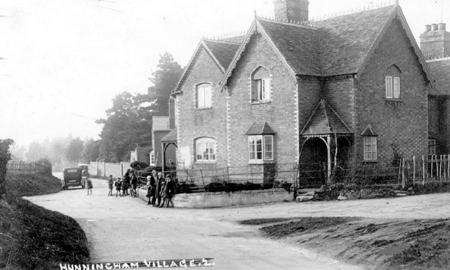 Semi-detached house, children in street outside it and motor cars on the road, Hunningham.  1930s |  IMAGE LOCATION: (Warwickshire County Record Office)