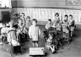 George Street Infants' School nursery class, Bedworth. Pupils posing with toys.  1930s |  IMAGE LOCATION: (Warwickshire County Record Office)