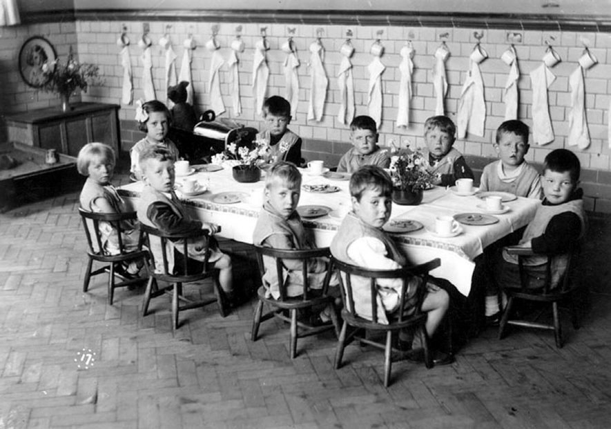 George Street Infants' School nursery class eating at table, Bedworth.  1930s |  IMAGE LOCATION: (Warwickshire County Record Office)
