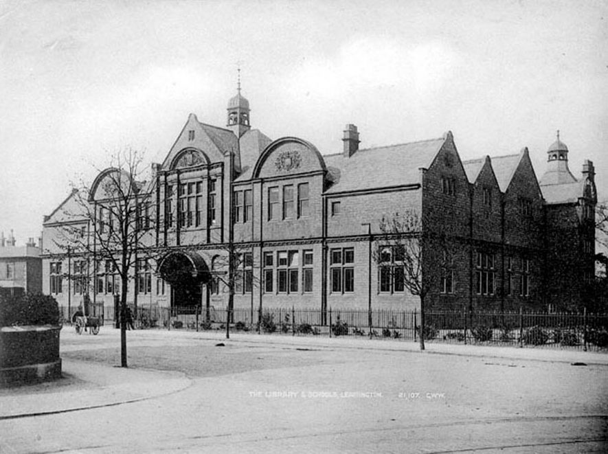 Public Library and Schools in Leamington Spa. Man in street with handcart.  1900s    IMAGE LOCATION: (Warwickshire County Record Office)