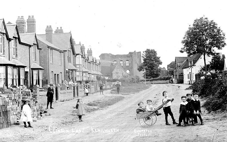 Children playing in Clinton Lane, Kenilworth with part of the castle in the background.  1900s |  IMAGE LOCATION: (Warwickshire County Record Office)