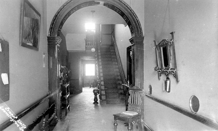 Interior view of hall and staircase in Abbotsford School, Kenilworth.  1910s |  IMAGE LOCATION: (Warwickshire County Record Office)