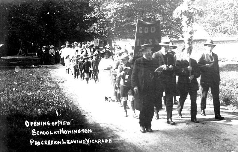 Procession leaving the vicarage on the occasion of the opening of the new school at Honington.  1900s |  IMAGE LOCATION: (Warwickshire County Record Office)