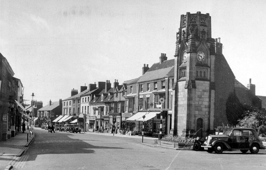 View of the Square and clock tower, looking towards the Warwick road.  1950s |  IMAGE LOCATION: (Warwickshire County Record Office)