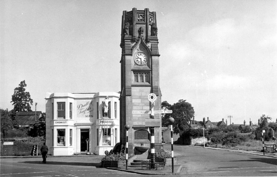 The clock tower at the junction of the Square with Borrowell lane with Dudley Taylor's the Chemist shop.  1950s |  IMAGE LOCATION: (Warwickshire County Record Office)