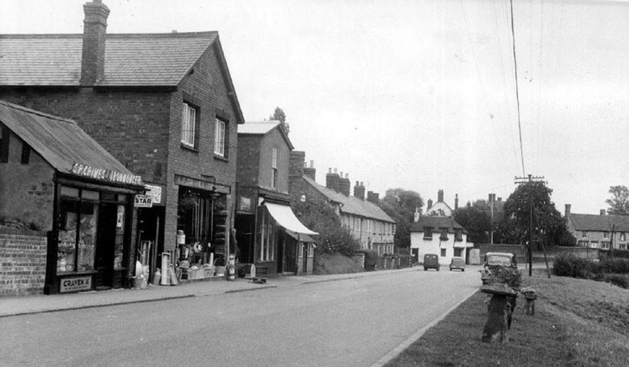 Banbury Street in Kineton showing the ironmonger S.P. Grimes with hardware stocked outside the shop.  1950s |  IMAGE LOCATION: (Warwickshire County Record Office)