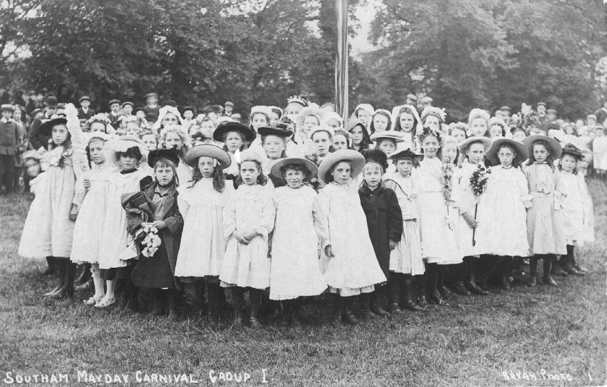 May Day Carnival, Group of girls gathered around the May pole.  1900s |  IMAGE LOCATION: (Warwickshire County Record Office)