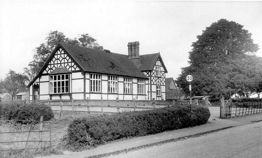 The school building and playground at Ladbroke.  1960s |  IMAGE LOCATION: (Warwickshire County Record Office)