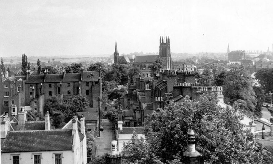 View of All Saints Parish Church and surrounding buildings, Leamington Spa.  1950s |  IMAGE LOCATION: (Warwickshire County Record Office)