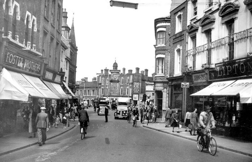 Market Place, Rugby with clocktower in the background. 1950s |  IMAGE LOCATION: (Warwickshire County Record Office)