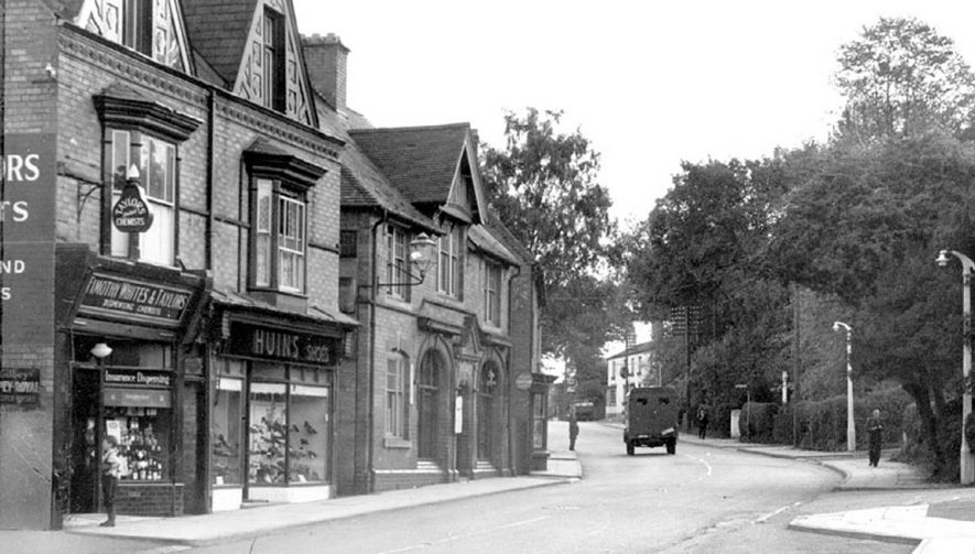 A chemist's shop, a shoe shop and the old post office in Alcester Road, Studley.  1950s |  IMAGE LOCATION: (Warwickshire County Record Office)