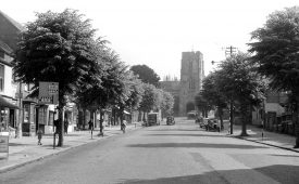West Street with view of St James' church on top of West Gate, Warwick.  1950s |  IMAGE LOCATION: (Warwickshire County Record Office)