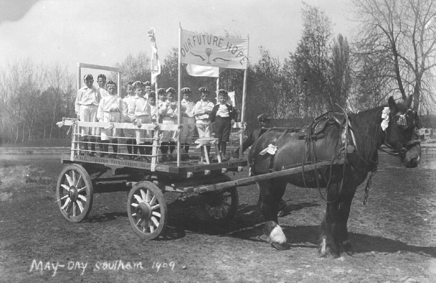 May Day 1909; horse drawn cart in a field, with the inscription 'W. Neal, Stockton, Warwickshire', containing a group of young boys standing behind the banner 'Our Future Hope'.  1909 |  IMAGE LOCATION: (Warwickshire County Record Office)