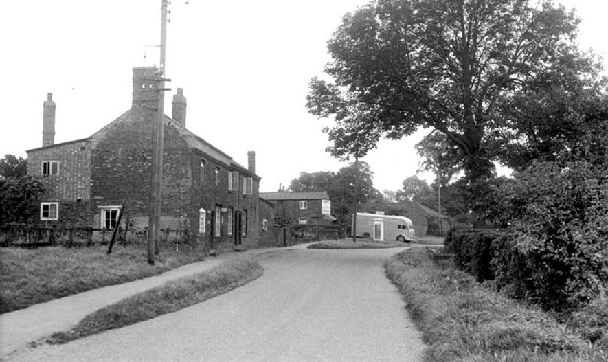 The Post Office, Willoughby. Telephone box and lorry.  1950s |  IMAGE LOCATION: (Warwickshire Museum Sites and Monuments Record) SCAN DATE: (1/7/8)