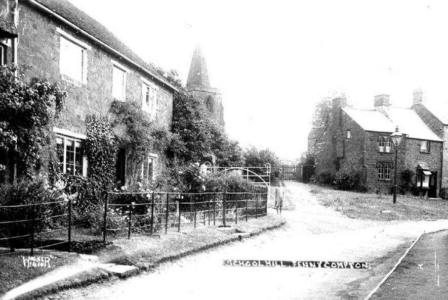 School Hill, Fenny Compton.  Showing church tower, stone cottages and street lamp.  1930s |  IMAGE LOCATION: (Warwickshire County Record Office)