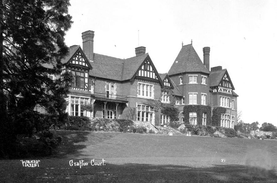Grafton Court, Temple Grafton. 1930s[The court is actually on the site of an older stately moated house that was burnt down. Signs of the moat in the gardens can still be seen. When the new Court was built the owners had the bell tower removed from the neighbouring Court Farm as it spoilt the view from the Court. The bell is now situated on the west side of the old servants quarters of Court Farm. The Court was also used for some time as a hotel but has now been seperated into into different apartments and sold off as flats.] |  IMAGE LOCATION: (Warwickshire County Record Office)