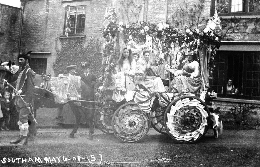 Decorated horse-drawn float outside the Abbey, with men and women in fancy dress for May Day.  May 1908. Photo: no. 5. |  IMAGE LOCATION: (Warwickshire County Record Office)